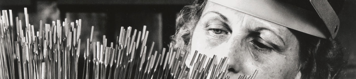 Virgina Robinson making a final inspection of tiny bulb and capillary tubes as components for modern temperature controls