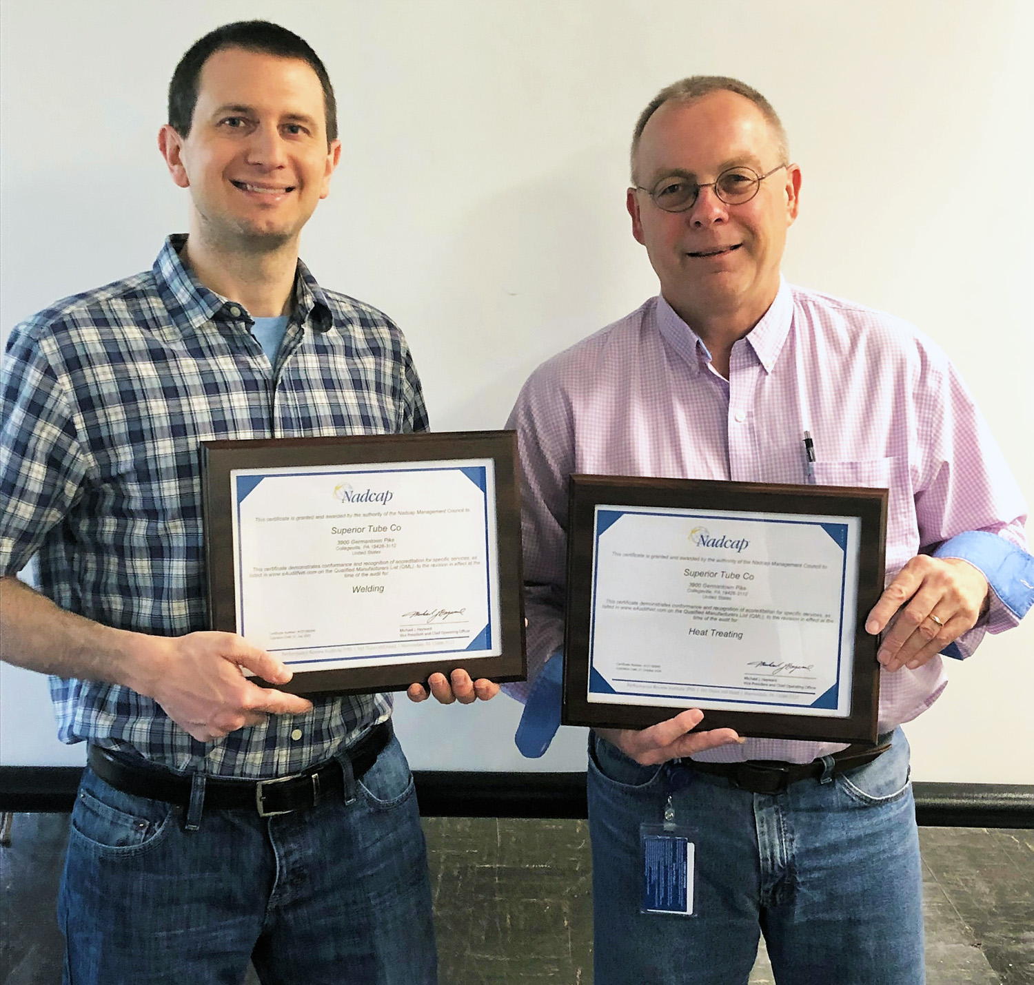 Scott Bussinger, Quality Manager, and Brian Gorney, Process Engineer, with new Superior Tube Nadcap Certificates